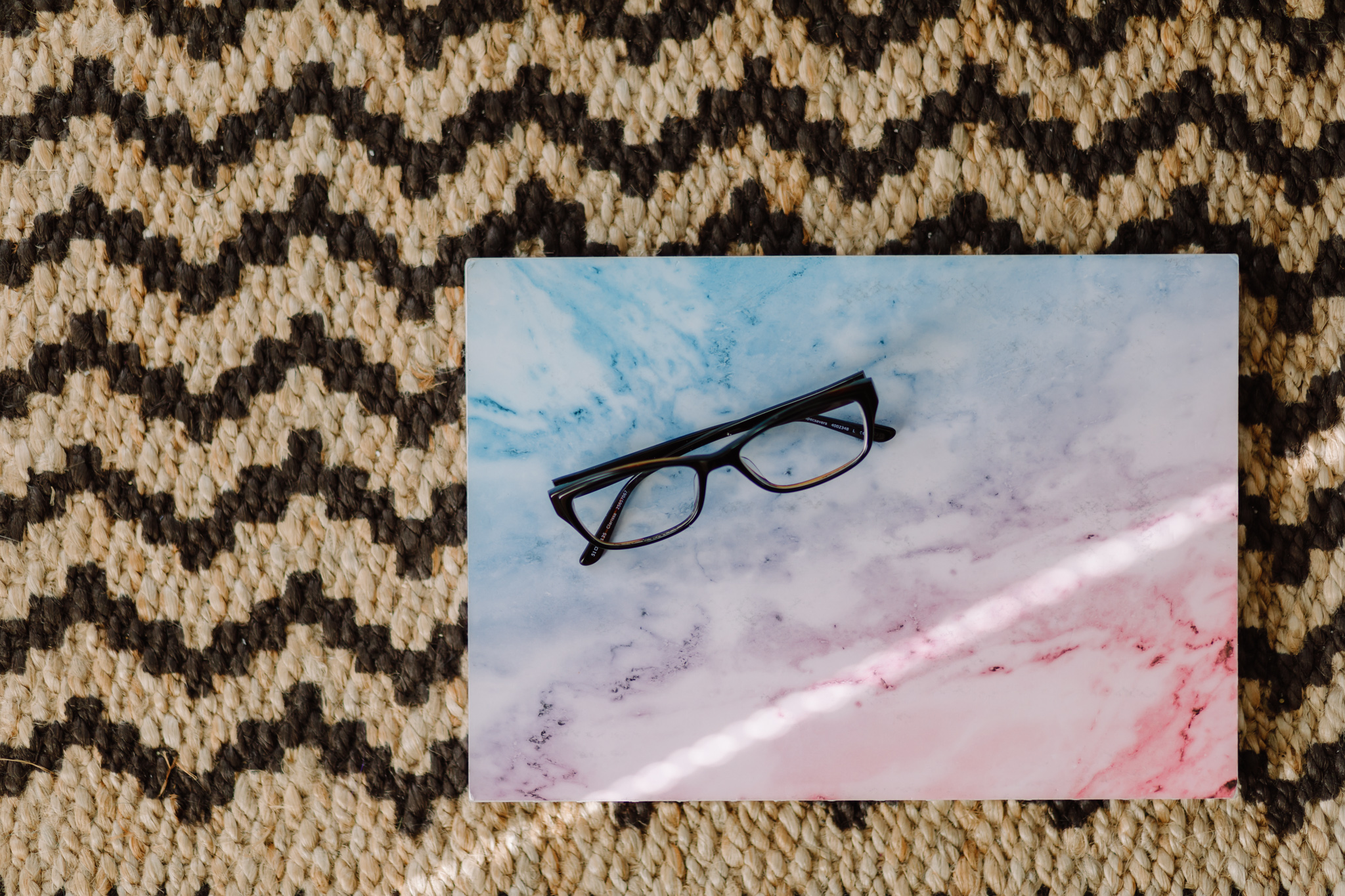 notebook with glasses as beam of light falls across
