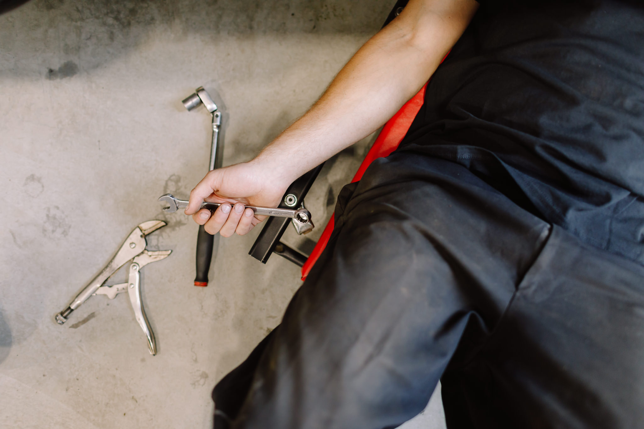 Hand holding mechanical tools
