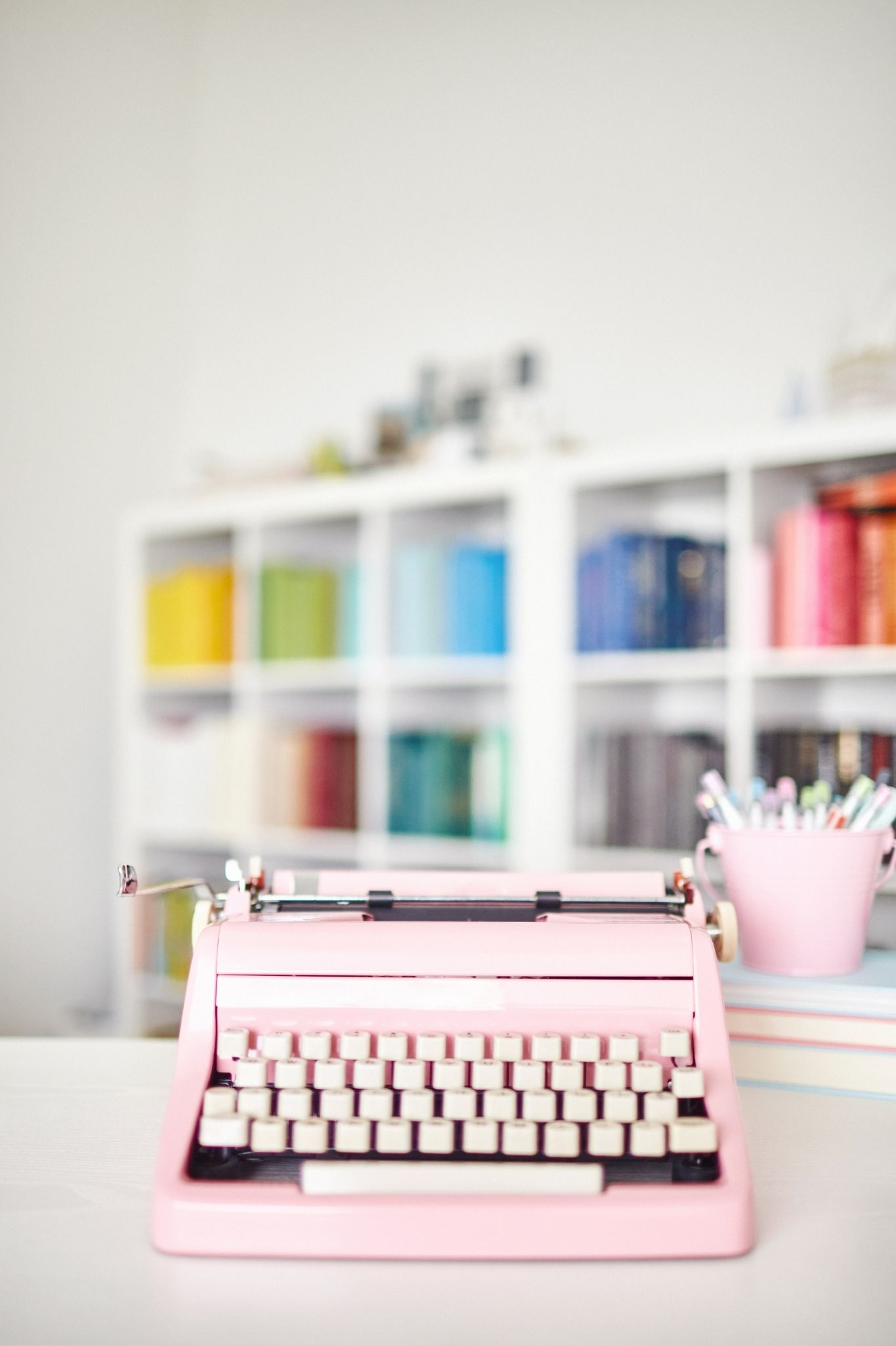 Pink typewriter for writing blog posts